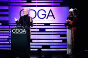 (L-R) Ryan Murphy accepts the Distinguished Collaborator Award from Lou Eyrich and Sarah Paulson onstage during The 21st CDGA (Costume Designers Guild Awards) at The Beverly Hilton Hotel on February 19, 2019 in Beverly Hills, California.