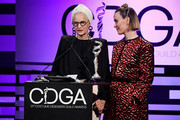 Lou Eyrich (L) and Sarah Paulson speak onstage during The 21st CDGA (Costume Designers Guild Awards) at The Beverly Hilton Hotel on February 19, 2019 in Beverly Hills, California.