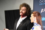 Actor T.J. Miller (L) and actress Kate Gorney pose in the press room during The 22nd Annual Critics' Choice Awards at Barker Hangar on December 11, 2016 in Santa Monica, California.