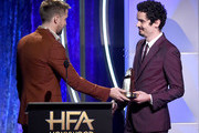 Damien Chazelle (R) accepts the Hollywood Director Award from Ryan Gosling (L) onstage during the 22nd Annual Hollywood Film Awards at The Beverly Hilton Hotel on November 4, 2018 in Beverly Hills, California.