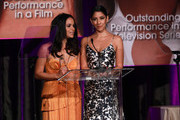 Actresses Melissa Fumero (L) and Stephanie Beatriz speak onstage during the 22nd Annual National Hispanic Media Coalition Impact Awards Gala at Regent Beverly Wilshire Hotel on February 22, 2019 in Beverly Hills, California.