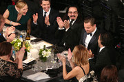Actress Kate Winslet (L) and the table congratulate actor Leonardo DiCaprio on his win for Outstanding Performance by a Male Actor in a Leading Role for 'The Revenant' during The 22nd Annual Screen Actors Guild Awards at The Shrine Auditorium on January 30, 2016 in Los Angeles, California. 25650_022