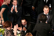 Actress Kate Winslet (L) and the table congratulate actor Leonardo DiCaprio (R) on his win for Outstanding Performance by a Male Actor in a Leading Role for 'The Revenant' during The 22nd Annual Screen Actors Guild Awards at The Shrine Auditorium on January 30, 2016 in Los Angeles, California. 25650_022