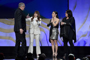 (L-R) Honoree Adam McKay accepts the Distinguished Collaborator award from Lorene Scafaria, Constance Wu, and Susan Matheson onstage during the 22nd CDGA (Costume Designers Guild Awards) at The Beverly Hilton Hotel on January 28, 2020 in Beverly Hills, California.