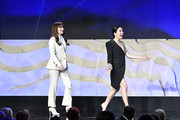 (L-R) Lorene Scafaria and Constance Wu walk onstage during the 22nd CDGA (Costume Designers Guild Awards) at The Beverly Hilton Hotel on January 28, 2020 in Beverly Hills, California.
