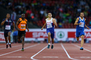 (L-R) Ben Bassaw of France, Churandy Martina of the Netherlands, Adam Gemili of Great Britain and Northern Ireland and Likourgos-Stefanos Tsakonas of Greece compete in the Men's 200 metres semi-final during day three of the 22nd European Athletics Championships at Stadium Letzigrund on August 14, 2014 in Zurich, Switzerland.