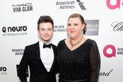 Actor Chris Colfer and actress Ashley Fink attend the 23rd Annual Elton John AIDS Foundation Academy Awards Viewing Party on February 22, 2015 in Los Angeles, California.
