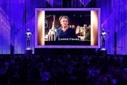 Actress Carrie Fisher is seen on a screen during the in Memoriam of the 23rd Annual Screen Actors Guild Awards show at The Shrine Auditorium on January 29, 2017 in Los Angeles, California. / AFP / Robyn BECK