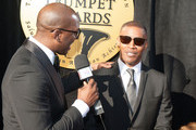 Isaac Carree interviews Jamie Foxx on the red carpet during the 23rd Annual Trumpet Awards at Cobb Energy Performing Arts Center on January 24, 2015 in Atlanta, Georgia.