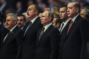 TOPSHOT - Russian President Vladimir Putin (C), Turkish President Recep Tayyip Erdogan (R), Azerbaijan's President Ilham Aliev (2nd L) and Turkish Prime Minister Binali Yildirim (L) attend the 23rd World Energy Congress on October 10, 2016 in Istanbul. .Russian President Vladimir Putin arrived in Istanbul on October 10 on his first trip to Turkey following a crisis sparked by the shooting down of a Russian war plane over Syria last November. / AFP / OZAN KOSE