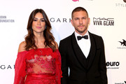 Actors Thaila Ayala and Adam Senn attend the 24th Annual Elton John AIDS Foundation's Oscar Viewing Party on February 28, 2016 in West Hollywood, California.