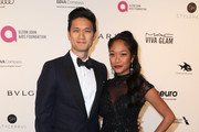 Actor Harry Shum Jr. (R) and actress Shelby Rabara  attends the 24th Annual Elton John AIDS Foundation's Oscar Viewing Party on February 28, 2016 in West Hollywood, California.