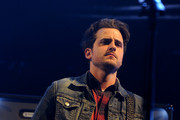 Musician Jared Followill of Kings of Leon performs onstage during The 24th Annual KROQ Almost Acoustic Christmas at The Shrine Auditorium on December 7, 2013 in Los Angeles, California.