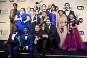 (Standing row L-R) Actors Jermel Nakia, Chrissy Metz, Alexandra Breckenridge, Mandy Moore, Hannah Zeile, Logan Shroyer, Lonnie Chavis, Chris Sullivan, Susan Kelechi Watson, Eris Baker, Milo Ventimiglia, and Faithe Herman, (Seated row L-R) Actors Sterling K. Brown, Niles Fitch, Justin Hartley, and Jon Huertas, winners of Outstanding Performance by an Ensemble in a Drama Series for 'This Is Us,' pose in the press room during the 24th Annual Screen ActorsGuild Awards at The Shrine Auditorium on January 21, 2018 in Los Angeles, California.