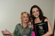Actresses Kristin Davis and Tippi Hedren backstage at the 25th Anniversary Genesis Awards hosted by the Humane Society of the United States held at the Hyatt Regency Century Plaza Hotel on March 19, 2011 in Los Angeles, California.