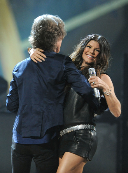 Mick Jagger of The Rolling Stones and Fergie of Black Eyed Peas perform with U2 onstage at the 25th Anniversary Rock & Roll Hall of Fame Concert at Madison Square Garden on October 30, 2009 in New York City.