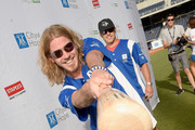 Singer Bucky Covington steps up to strike out cancer at City of Hope's 25th Annual Celebrity Softball Game at First Tennessee Park on June 13, 2015 in Nashville, Tennessee.
