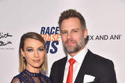 Natalie Zea (L) and Travis Schuldt attend the 25th Annual Race To Erase MS Gala at The Beverly Hilton Hotel on April 20, 2018 in Beverly Hills, California.