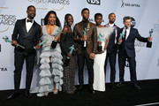 (L-R) Sterling K. Brown, winner of Outstanding Performance by a Cast in a Motion Picture for 'Black Panther' and Outstanding Performance by an Ensemble in a Drama Series for 'This Is Us;' Angela Bassett, Lupita Nyong'o, Chadwick Boseman, Danai Gurira, Michael B. Jordan, and Andy Serkis, winners of Outstanding Performance by a Cast in a Motion Picture for 'Black Panther,' pose in the press room at the 25th annual Screen ActorsGuild Awards at The Shrine Auditorium on January 27, 2019 in Los Angeles, California.