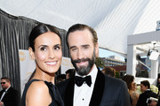 (L-R) Maria Dolores Dieguez and Joseph Fiennes attend the 25th Annual Screen Actors Guild Awards at The Shrine Auditorium on January 27, 2019 in Los Angeles, California.