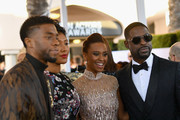 (L-R) Chadwick Boseman, Taylor Simone Ledward, Ryan Michelle Bathe, and Sterling K. Brown attend the 25th Annual Screen ActorsGuild Awards at The Shrine Auditorium on January 27, 2019 in Los Angeles, California. 480543