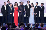 (L-R) Brian Tarantina, Zachary Levi, Kevin Pollak, Marin Hinkle, Tony Shalhoub, Luke Kirby, Rachel Brosnahan, Michael Zegen, and Joel Johnstone accept the Outstanding Performance by an Ensemble in a Comedy Series awrad for 'The Marvelous Mrs Maisel' onstage during the 25th Annual Screen ActorsGuild Awards at The Shrine Auditorium on January 27, 2019 in Los Angeles, California.