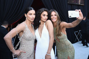 (L-R) Adriana Lima, Shanina Shaik and  Heidi Klum attend the 26th annual Elton John AIDS Foundation Academy Awards Viewing Party sponsored by Bulgari, celebrating EJAF and the 90th Academy Awards at The City of West Hollywood Park on March 4, 2018 in West Hollywood, California.