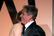 Lionsgate CEO Jon Feltheimer (R) accepts the Milestone Award from actress Jennifer Lawrence onstage during the 26th Annual Producers Guild Of America Awards at the Hyatt Regency Century Plaza on January 24, 2015 in Los Angeles, California.