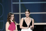 (L-R) Kaitlyn Dever and Lili Reinhart speak onstage during the 26th Annual Screen Actors Guild Awards at The Shrine Auditorium on January 19, 2020 in Los Angeles, California. 721359