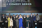 (L-R) Tony Shalhoub, Kevin Pollak, Alex Borstein, Stephanie Hsu, Michael Zegen, Marin Hinkle, Rachel Brosnahan, Caroline Aaron, Joel Johnstone, Matilda Szydagis, and Jane Lynch accept Outstanding Performance by an Ensemble in a Comedy Series for 'The Marvelous Mrs. Maisel' with Sterling K. Brown onstage at the 26th Annual Screen Actors Guild Awards at The Shrine Auditorium on January 19, 2020 in Los Angeles, California. 721359