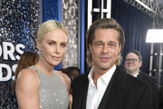 (L-R) Charlize Theron and Brad Pitt attend the 26th Annual Screen ActorsGuild Awards at The Shrine Auditorium on January 19, 2020 in Los Angeles, California.