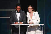 (L-R) Jharrel Jerome and Millie Bobby Brown speak onstage during the 26th Annual Screen ActorsGuild Awards at The Shrine Auditorium on January 19, 2020 in Los Angeles, California.