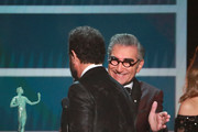 Eugene Levy (R) presents Tony Shalhoub with the Outstanding Performance by a Male Actor in a Comedy Series for 'The Marvelous Mrs. Maisel' onstage during the 26th Annual Screen Actors Guild Awards at The Shrine Auditorium on January 19, 2020 in Los Angeles, California.