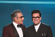 (L-R) Eugene Levy and Dan Levy speak onstage during the 26th Annual Screen Actors Guild Awards at The Shrine Auditorium on January 19, 2020 in Los Angeles, California.