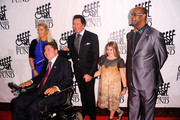 Kathleen McCrone, Marc Buoniconti, Wayne Newton and Bob Beamon attend the 26th Annual Great Sports Legends Dinner to benefit the Buoniconti Fund To Cure Paralysis at The Waldorf=Astoria on September 26, 2011 in New York City.