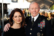 Gloria Estefan and General Martin E. Dempsey, Chairman, Joint Chiefs of Staff, pose for a photo at the 26th National Memorial Day Concert on May 24, 2015 in Washington, DC.