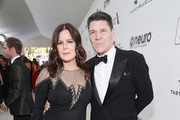 Marcia Gay Harden (L) and Greg Calejo attend the 27th annual Elton John AIDS Foundation Academy Awards Viewing Party sponsored by IMDb and Neuro Drinks celebrating EJAF and the 91st Academy Awards on February 24, 2019 in West Hollywood, California.