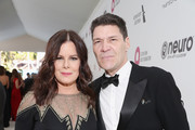 (L-R) Marcia Gay Harden and Greg Calejo attend the 27th annual Elton John AIDS Foundation Academy Awards Viewing Party sponsored by IMDb and Neuro Drinks celebrating EJAF and the 91st Academy Awards on February 24, 2019 in West Hollywood, California.