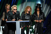 Inductees (L-R)  Matt Sorum, Slash and Steven Adler of Guns N' Roses, perform onstage during the 27th Annual Rock And Roll Hall of Fame Induction Ceremony at Public Hall on April 14, 2012 in Cleveland, Ohio.