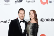 (L-R) Jason Lewis and Liz Godwin attend the 28th Annual Elton John AIDS Foundation Academy Awards Viewing Party sponsored by IMDb, Neuro Drinks and Walmart on February 09, 2020 in West Hollywood, California.