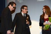 SBIFF director Roger Durling, director David O. Russell, and actress Melissa Leo attend the presentation of the Outstanding Director Award at the Arlington Theatre at the 29th Santa Barbara International Film Festival on January 31, 2014 in Santa Barbara, California.