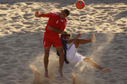 Takasuke Goto of Japan and Hussein Al Saleh of Lebanon fight for the ball in the Men's First Round Group C Match 9  Beach Soccer match between Japan and Lebanon at Al-Musannah Sports City during day three of the 2nd Asian Beach Games Muscat 2010 on December 10, 2010 in Muscat, Oman.