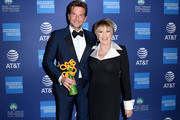 Bradley Cooper, recipient of the Director of the Year Award (L) and Lorna Luft attend the 30th Annual Palm Springs International Film Festival Film Awards Gala at Palm Springs Convention Center on January 3, 2019 in Palm Springs, California.