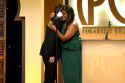 Mindy Kaling (R) presents The Danny Thomas Award for Outstanding Producer of Episodic Television ? Comedy to Daniel Palladino onstage during the 30th annual Producers Guild Awards at The Beverly Hilton Hotel on January 19, 2019 in Beverly Hills, California.