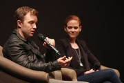Actors Noel Fisher and Katherine Willis speak onstage at 'The Long Road Home' screening and Q&A at Culbreth Theatre during the 30th Annual Virginia Film Festival at the University of Virginia on November 10, 2017 in Charlottesville, Virginia.