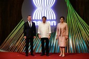 (L-R) Russian Prime Minister Dmitry Medvedev, Philippine President Rodrigo Duterte and his partner Cielito Avanceno pose for photos before the opening ceremony of the 31st Association of Southeast Asian Nations (ASEAN) Summit in Manila on November 13, 2017. .World leaders are in the Philippines' capital for two days of summits.  / AFP PHOTO / AFP PHOTO AND POOL / Mark R. CRISTINO