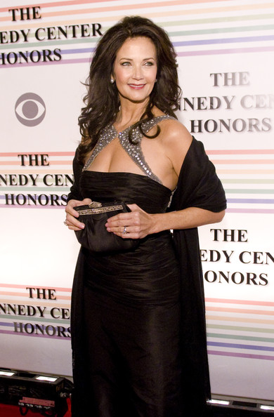 Lynda Carter poses for photographers on the red carpet before the 32nd Kennedy Center Honors at Kennedy Center Hall of States on December 6, 2009 in Washington, DC.