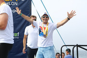 Mark Feuerstein onstage with the top triathlon performers onstage during the post race ceremony at the 33rd Annual Nautica Malibu Triathlon Presented By Bank Of America on September 15, 2019 in Malibu, California.