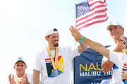 Steve Howey onstage with top triathlon performers onstage during the post race ceremony at the 33rd Annual Nautica Malibu Triathlon Presented By Bank Of America on September 15, 2019 in Malibu, California.