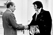 380450 08: President Richard Nixon shakes hands with Elvis Presley December 21, 1970 at the White House.